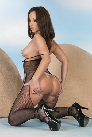 Brunette solo girl displays her incredible butt in an assless bodysuit