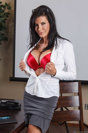 Business lady Shay Sights reveals her huge boobs as she disrobes in her office