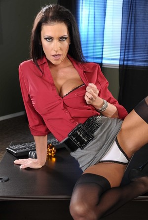 Dark haired businesswoman reveals her huge tits as she strips in her office
