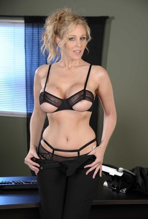 Blonde businesswoman plays with her twat after stripping to nylons at work