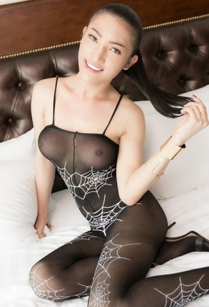 Asian ladyboy Nutty 2 wears a crotchless bodystocking while fucking a man