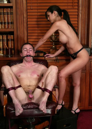 Smoking hot Dominatrix Shy Love ties up her slave and tortures him