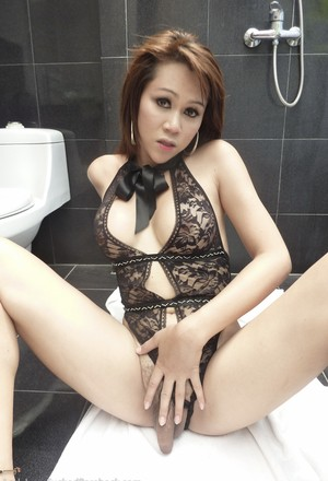 Petite Thai shemale with medium-sized dick licks ass, sucks and gets assfucked