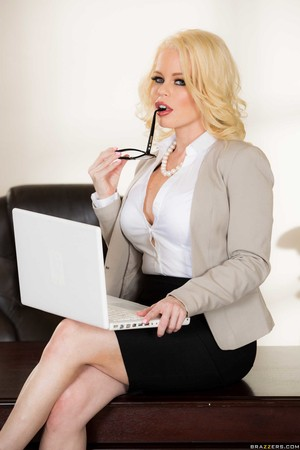 Hot blonde chick Nikki Delano dresses for work and strips naked in her office