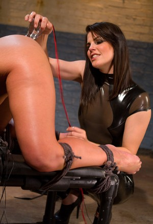Hot femdom in latex Bobbi Starr toying bootylicious Phoenix Marie's holes