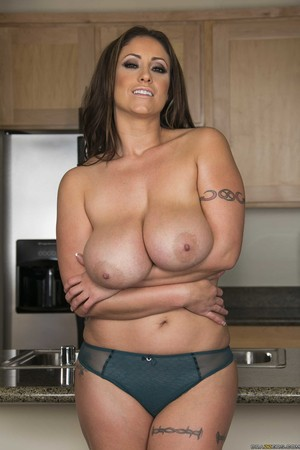 Hot MILF Eve Notty unleashes her massive boobs as she undresses in kitchen