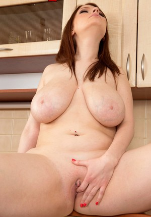 German Sofie Style is up for revealing her big boobs and pussy in the kitchen
