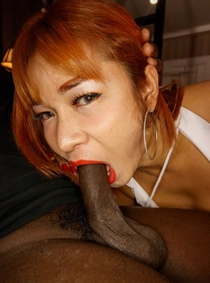 Red-haired ladyboy from Asia gets her anal hole blacked by masked guy