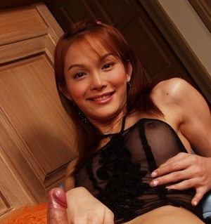 Pretty Asian shemale Mickey 2 jerks off in sheer lingerie and mules