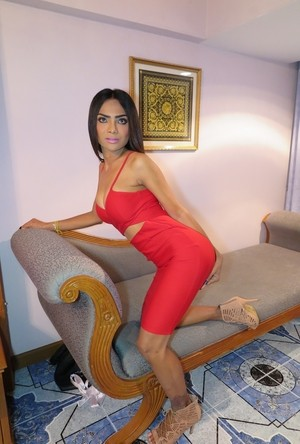 Exotic Asian transvestite Amy teasing in her tight red dress and high heels