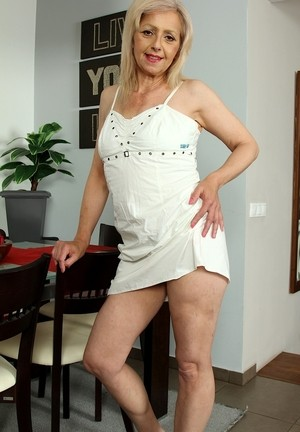Mature housewife Shiela flaunts her wolf hairy pussy at the dinning table
