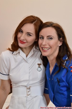 Older and younger dykes hike up nurse's outfits in nylons and garters