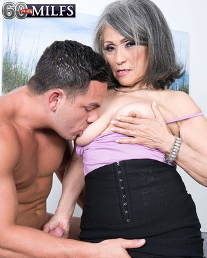 Asian granny Kokie Del Coco gets her hairy muff stuffed with a stud's cock