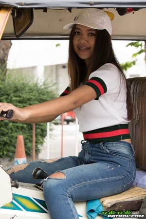 Petite Thai girl Mint removes ripped jeans to display her pussy in stockings