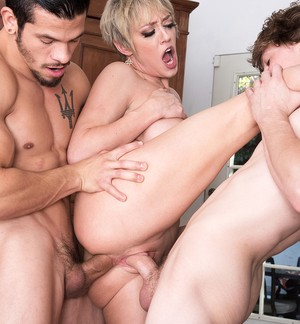 Blonde Dee Williams gets two hard peckers inside of her love tunnels