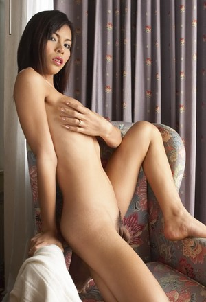 Aroused ladyboy Minty shows her hot body while teasing with her cock