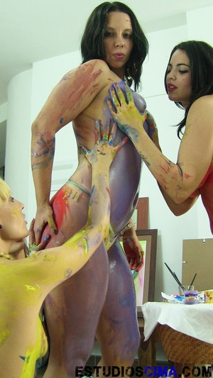 Lesbians Victoria Blonde and Naomi Burning paint each other's naked bodies