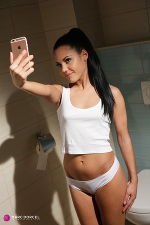 Apolonia Lapiedra uses a dildo and takes selfies in the public bathroom