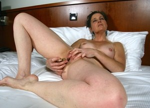 Mature Dutch lady Kim S attends to her shaved pussy during masturbation time
