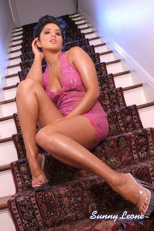 Classy Canadian chick Sunny Leone slides her hands down panties in short dress