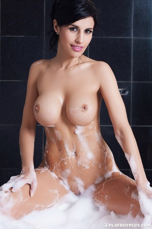 Argentinian beauty Laura Cattay takes a bubble bath for Playboy