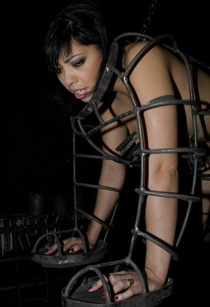 Filipina female Satine Phoenix is kept in a metal cage that has been suspended