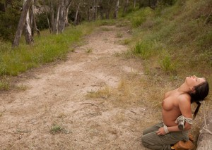 Busty chick is tied up and forced into a blowbang on a camping trip
