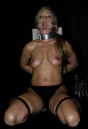 Naked blonde chick Dia Zerva is covered in clothespins in a dungeon