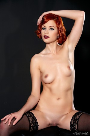 Sexy redhead Kami Arias takes off her bra and panty set to model in stockings