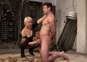 Leather attired Mistress Lorelei Lee trains her newest male sub