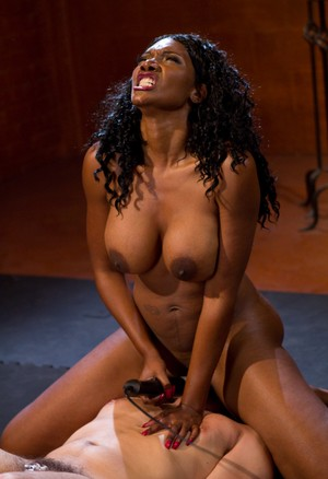 Black dominatrix Nyomi Banxxx face sits and tramples a white man