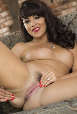 Enticing brunette Ava Dalush reveals her big naturals & ample shapely ass