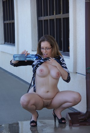 Woman with glasses Samantha flashes her round tits and trimmed pussy outdoors