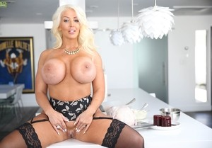 Middle-aged lady Alura Jenson uncorks her hooters while cooking in the kitchen