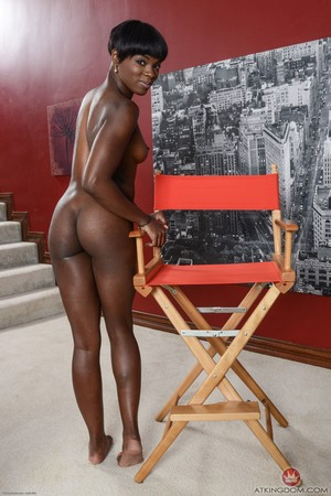 Athletic black woman Ana Foxxx demonstrates the pinkish interior of her cunt