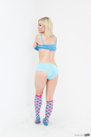 Blonde girl Ash Hollywood stands proud after stripping to knee high socks