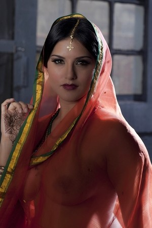 Busty solo girl Sunny Leone models solo in see thru Indian attire