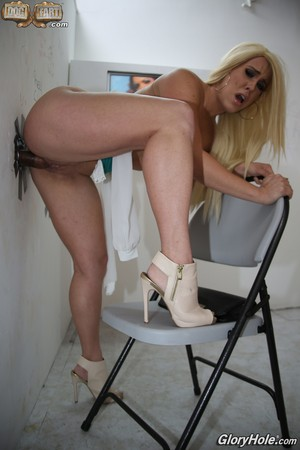 Blonde chick with no tattoos and a big butt sucks a off a cock at a gloryhole
