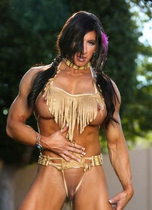 Muscled female Angela Salvagno exposes her big clit in Native American garb