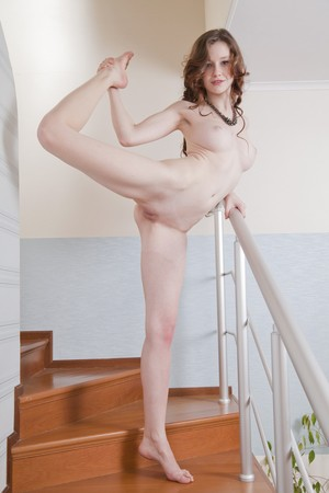 Emily Bloom with pale skin, pretty tits, and flexible body poses on stairs