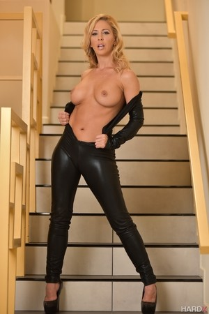 Hot blond chick Cherie DeVille cups her nice tits as she removes her catsuit