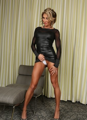 Blonde MILF with tanned muscled body Brandi Mae opens her sexy legs