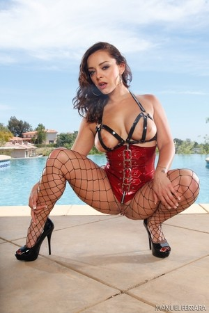 French solo model Liza del Sierra poses non nude in a corset and fishnets