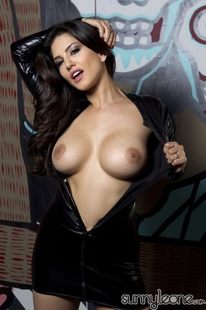 Gorgeous Sunny Leone flings latex dress open in front of graffiti wall
