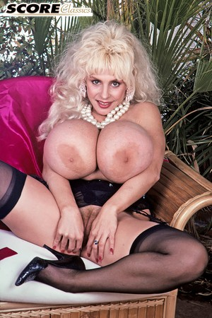 Old-fashioned magazine nude model Lulu Devine bares giant heavy tits and pussy