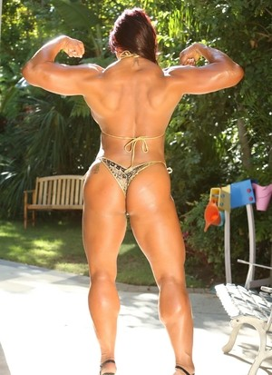 Redhead bodybuilder Amber Deluca shows her sexy muscle body and pink holes