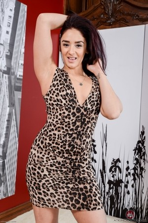 Sheena Ryder strips her leopard dress off and exposes her trimmed mature pussy