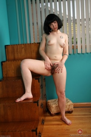 Dark haired chick Ruby Roxx exposes her awesome bush in black pumps