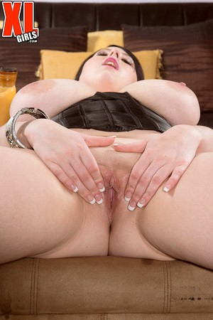 Dark haired fatty Kamille Amora whips out her hooters before pussy play