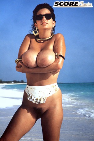 Wild Devon Daniels plays with her enormous natural breasts at the beach